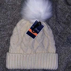 Women's winter hat with puff ball